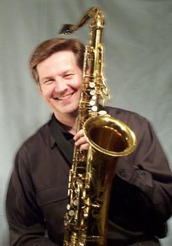 Jim Cutler Holding Saxophone
