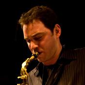 Gordon Brown playing saxophone