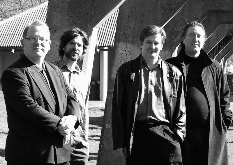 Four men standing